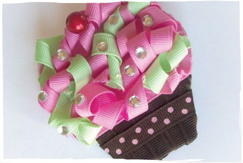 oh my gosh... cupcake hair clip made out of ribbon... which one of my baby girls needs this?