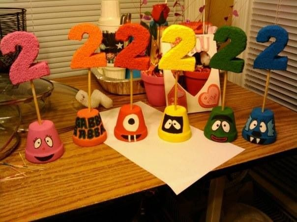 Yo Gabba Gabba birthday party.. table centerpieces. I added balloons to them the day of the party