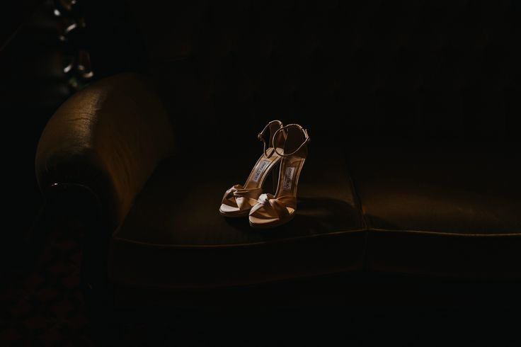 Love how the lighting makes these gorgeous ivory Jimmy Choos looks so expensive! Photo by Benjamin Stuart Photography #weddingphotography #jimmychoo #weddingshoes #bride #bridalshoes #weddingday