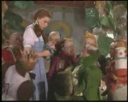 """""""Ding Dong the Witch is Dead"""" (song and Munchkin parade), The Wizard of Oz, Judy Garland, movie, 1939."""