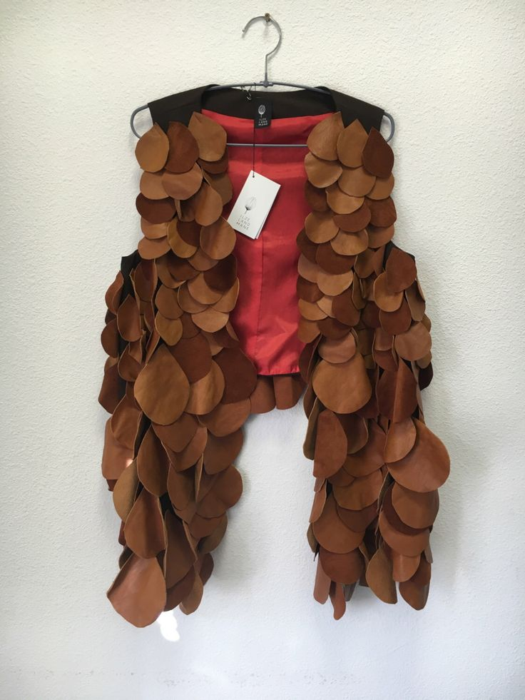 A personal favourite from my Etsy shop https://www.etsy.com/listing/272835098/leather-vest-recycled-leather-pieces