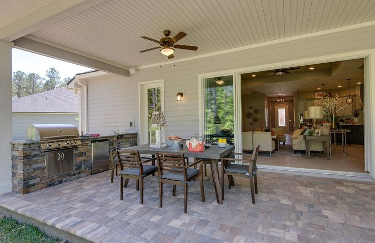 Lovely Covered Outdoor Living Area With Patio Furniture And Grilling Station; The  Marco Floor Plan,