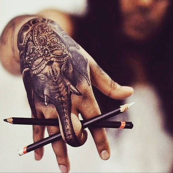 10. Magical elephant image on the hand A detailed tribal ink depicts an ornate elephant, the image extends over the whole hand and the figure of the trunk covers the middle finger. In fact, the animal, wearing an Indian trident, indicates a multi-faceted person, who is the creator and destroyer of his own destiny. - source