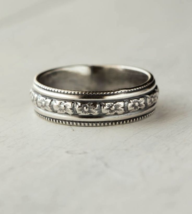 Floral Sterling Silver Band | This detailed floral band would make a worthy companion for a ... | Rings