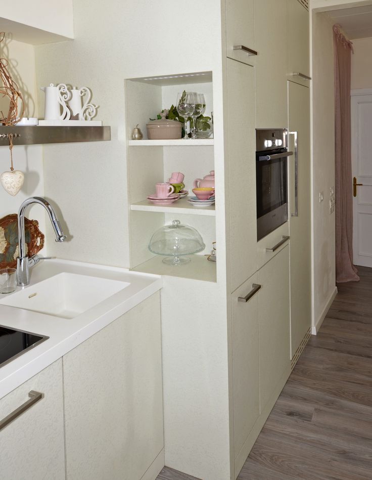 Detail: laminate column unit of a tailored kitchen, with  oven and fridge included.