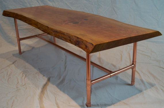 Thinking of painting the legs of our farm table with a matte finish copper paint and dark waxing the top to give it a richer, darker look. (only pic I could find of a wooden table with copper legs for reference)