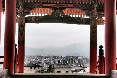 Ancient traditions meet urban sprawl in Kyoto, Japan.