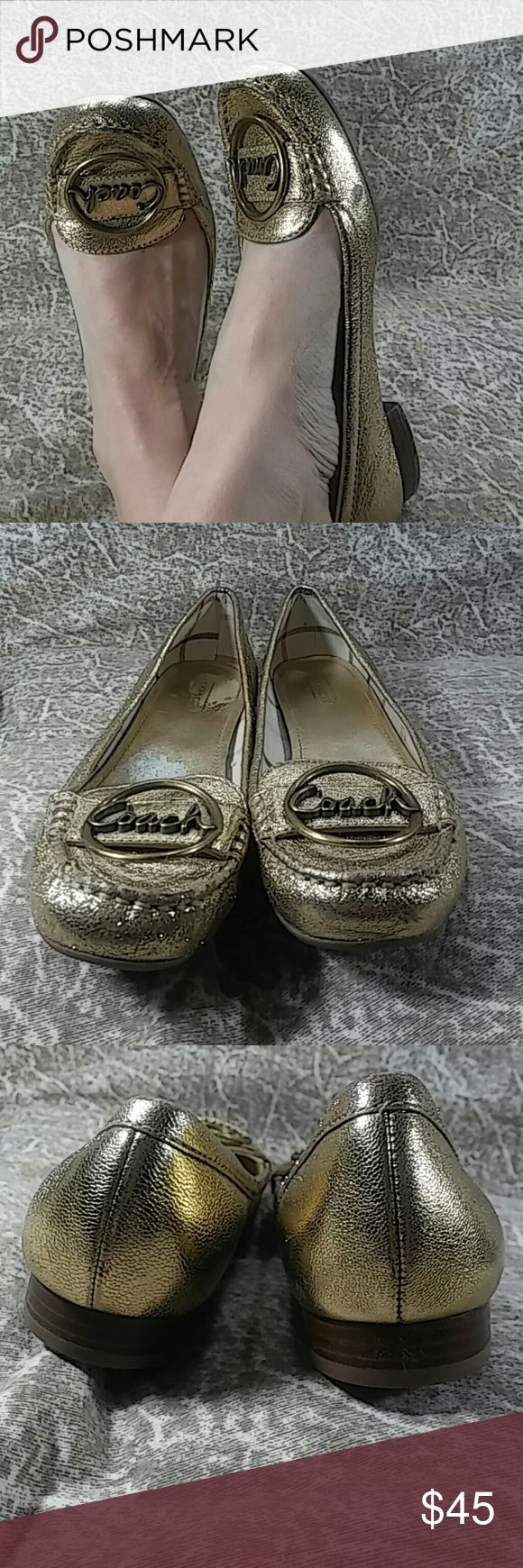 Size 8 gold Coach flats Size 8 gold Coach flats with gold tone metal emblem in good used condition Coach Shoes Flats & Loafers