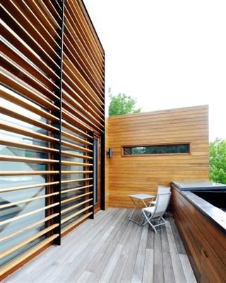 All of the south-facing windows feature either welded aluminum window shades or a torrified wood-siding blind to prevent summer passive heat gain but allowing winter heat gain. - Amsted Construction (Ottawa), CHBA winner 2012