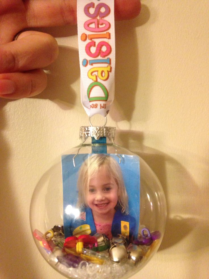 """Girl Scout Daisy ornament.  Glass ornament. Wallet sized photo (2 taped together so can see from both sides) with Popsicle stick that was cut - attached to photo so it stands up.  Filled with jingle bells, Daisy shaped buttons/beads and """"crystal snow"""" (vase filler)."""