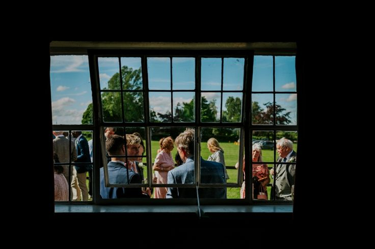 I love finding interesting perspectives to take photos from. Photo by Benjamin Stuart Photography #weddingphotography #guest #frame #window #weddingday #drinksreception