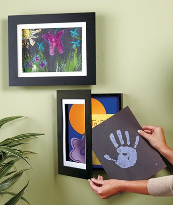 Easy Change Artwork Frames. Holds 50 pieces of kids artwork. Only $8.95. These are at JoAnn's. awesome!