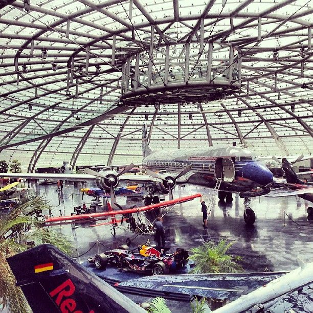 Ever wanted to visit one of the most badass hangars in the world? Visit Red Bull's Hangar-7 in Salzburg, Austria.  Not only does it have a fleet of airplanes and cars, but also a collection of shops and a top-notch restaurant.  Yum.