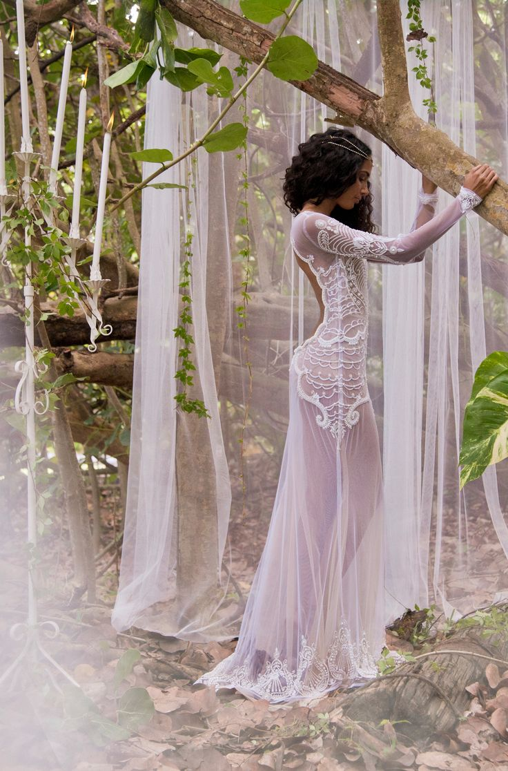 The Neaptune - an Intricate hand beaded sexy wedding gown. With stretch tulle and a nude illusion lining. Long sleeved and body hugging fit. From @islandbridals