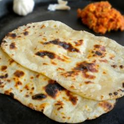 Homemade Naan - A step by step tutorial to make naan on stove top without adding yeast.