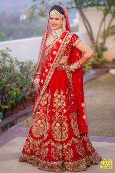 Real Indian Weddings - Nivriti and Siddharth | WedMeGood | Beautiful Bride Nivritti in a Bright Red Lehenga with Golden Embroidery and Double Dupatta wearing a Diamond and Pearl Set and Maatha Patti Picture Courtesy: Fotowale #wedmegood #realwedding #indianbride #indianweddding