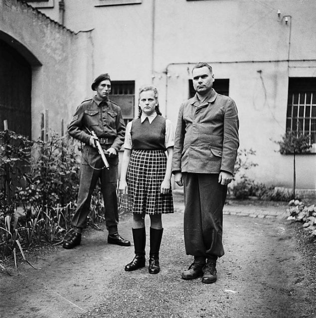 Guilty: Irma Grese, nicknamed 'The Beautiful Beast' pictured with two guards before she was hanged in 1945 at the age of 22