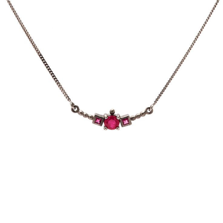 Rubies set in ruthenium plated sterling silver.