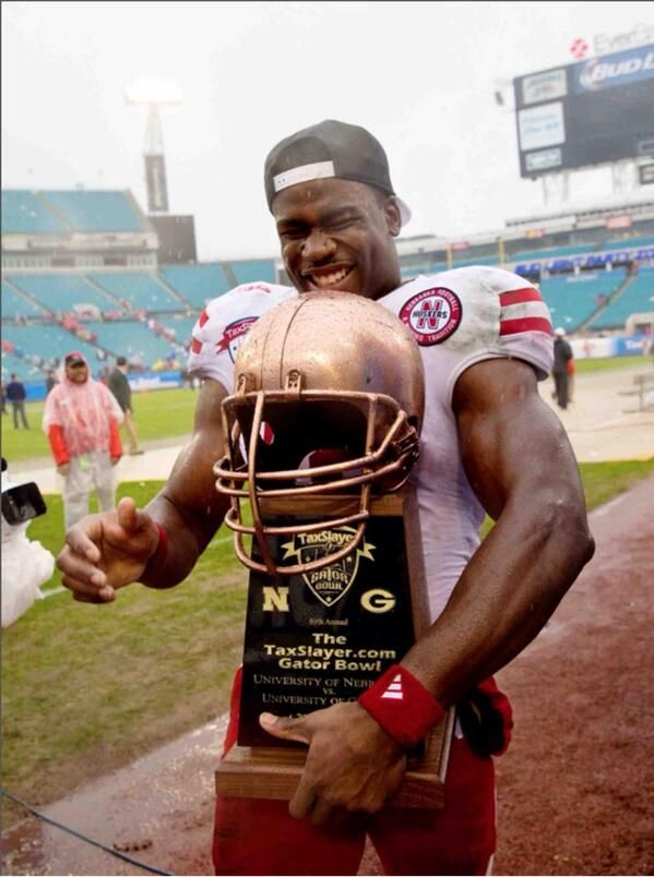 Tommy Armstrong Jr with the Taxslayer Gator Bowl Trophy after their  24-19 win over Georgia