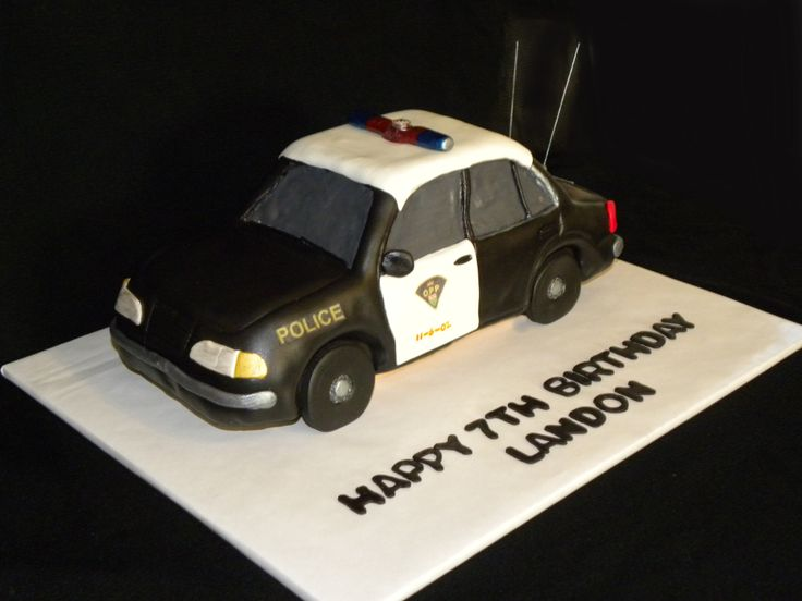 Police Car - Carved from the Wilton 3-D car cake pan.  All edible except for the flashing light button on the top.  Spaghetti for the antennas.  Thanks for looking!