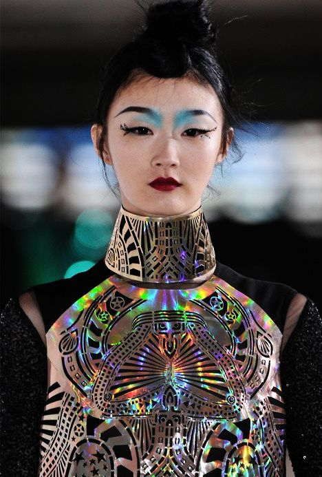 Manish Arora This laser cut holographic piece contrasting against black fabric is a very affective piece in my eyes.