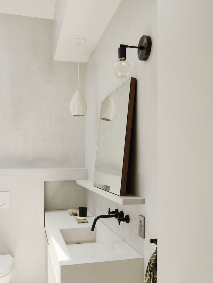 brooklyn bathroom with white plaster wall finishes and custom sink