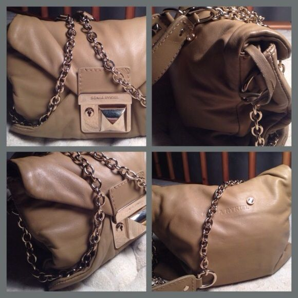 """Sonia Rykel Chain Bag This bag is made of the softest leather known to man! Beautiful hardware and equipped with key for locking and attached key fob on chain. Triple compartment interior. Practically new. Measures 8.5""""W x 6.5"""" H x 2.5"""" D Sonia Rykel Bags Shoulder Bags"""