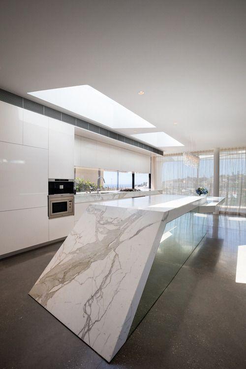 Mirrored Island, dont like counter top. Wood? Mirrored skirting around kitchen