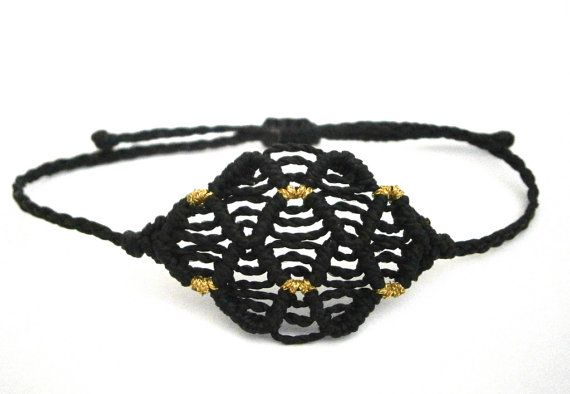 A macrame bracelet on black and gold colors. Carefully made and tight. Made by high quality polyester waxed thread The size is adjustable