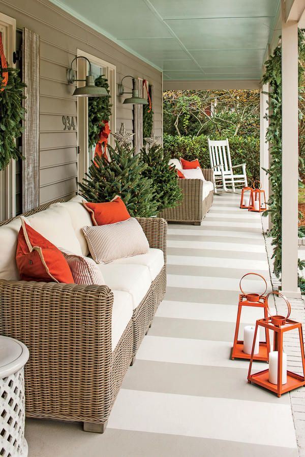 "Painted Top to BottomFor inexpensive upgrades to the porch's plywood ceiling and concrete floor, Calder brought on the color by giving the ceiling a coat of classic ""haint blue"" and the floor a bold cabana-stripe pattern. She also swapped the exterior's yellow-and-cream scheme for a fresher pairing of warm grays.        Wide stripes of gray floor paint in alternating shades give the porch's concrete floor the look of a flat-weave rug.  Love it? Get it! Siding paint: Fawn Brindle (7640)"
