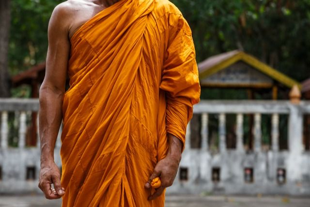 In Srilanka an orange / yellowish robe is traditionally worn by the local monks