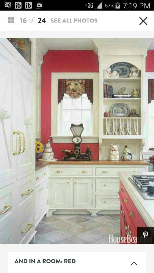 This otherwise neutral kitchen designed by Beverly Ellsley gets a dose of  energy from a vibrant red. Click through for more kitchen design and  remodeling ...