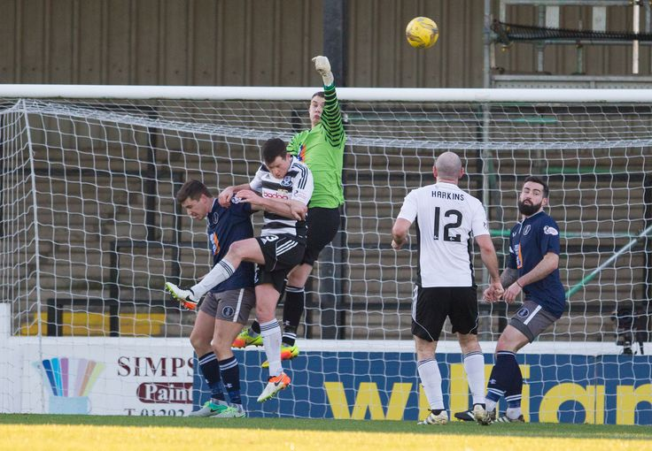 Queen's Park keeper Wullie Muir punches clear during the Scottish Cup round 4 game between Ayr United and Queen's Park.