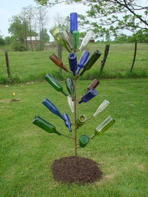 Bottle trees are an old Southern (mostly LA) tradition. I want to make one for my room with lights in it!