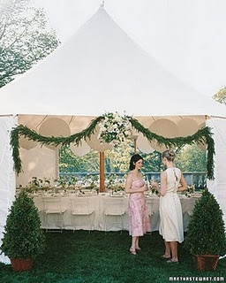 Tent decor- love the greenery and little shrubs!