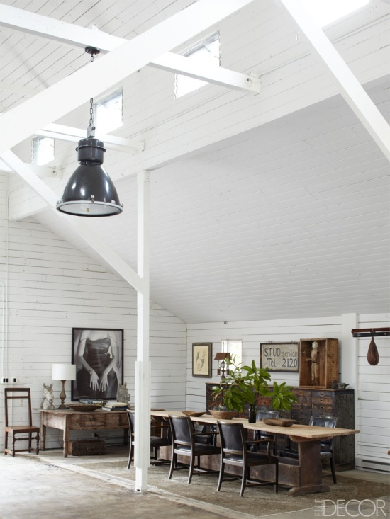 In the Art Barn, a 17th-century Swedish farm table is surrounded by circa-1930 Swedish armchairs; the Spanish desk is late 18th century, the cabinet is 19th century, the speed bag is antique, and the photograph is by an unknown artist.     Southern California Horse Ranch - Ellen DeGeneres Portia de Rossi Santa Monica Home - ELLE DECOR