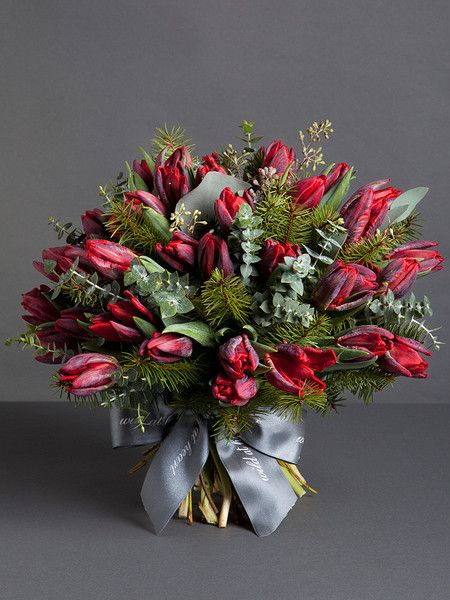 CLASSIC RED TULIPS BOUQUET      Uniquely shaped and exotically striped, these Rococo tulips mixed with pine and eucalyptus makes for a distinctive festive bouquet.  http://shop.wildatheart.com/collections/christmas-bouquets/products/classic-red-tulips-bouquet