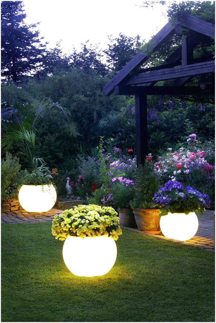 Lighted flower planters...I could see mom doing this!