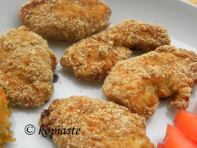 Kids love them and homemade nuggets are far better than the fast food version because you control the ingredients and can turn unhealthy meals into healthy ones!  Greek Breaded Cheesy Chicken Nuggets with Baked Potatoes / Κοτομπουκιές    http://kopiaste.wordpress.com/2012/09/17/greek-breaded-cheesy-chicken-nuggets-with-baked-potatoes-%CE%BA%CE%BF%CF%84%CE%BF%CE%BC%CF%80%CE%BF%CF%85%CE%BA%CE%B9%CE%AD%CF%82/