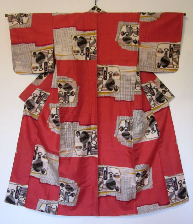 """Kimono  Silk, cotton (lining)  Stenciled warps and wefts    """"Japanese artists were familiar with cubism. The kimono shown here depicts two still lifes in the collage style made famous by Picasso and Braque."""""""