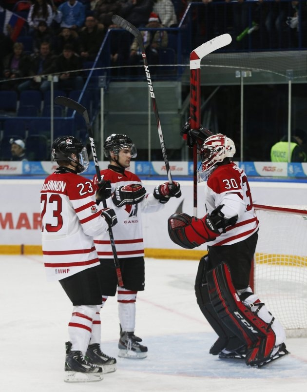 Canada's goalie Malcolm Subban (R), Ryan Murphy (C), and Nathan MacKinnon celebrate defeating Russia in their preliminary round game during the 2013 IIHF U20 World Junior Hockey Championship in Ufa, December 31, 2012.