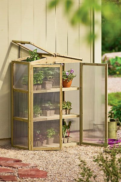 diy garage greenhouse | There is also a Compact Patio Grow House that is less expensive. Or ...