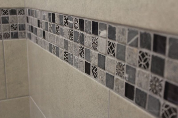 A Beautiful Black And Grey Mosaic With Some Patterned