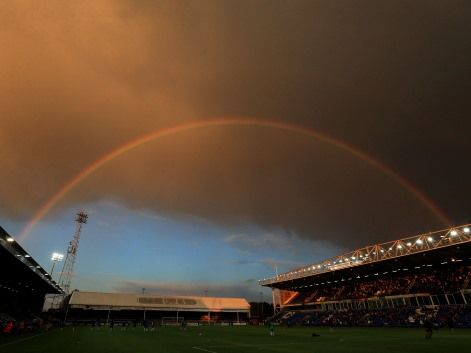 A rainbow is seen over London Road, the home of Peterborough United football club