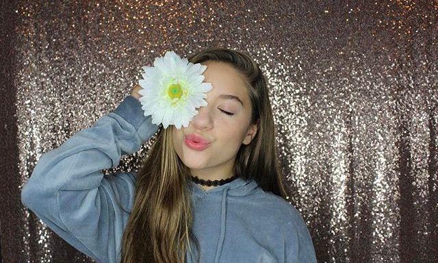 """Hi I'm Mackenzie I'm 15 and single. I am on YouTube and musically. I dance and sing."" I blow a kiss ""come say hi"""