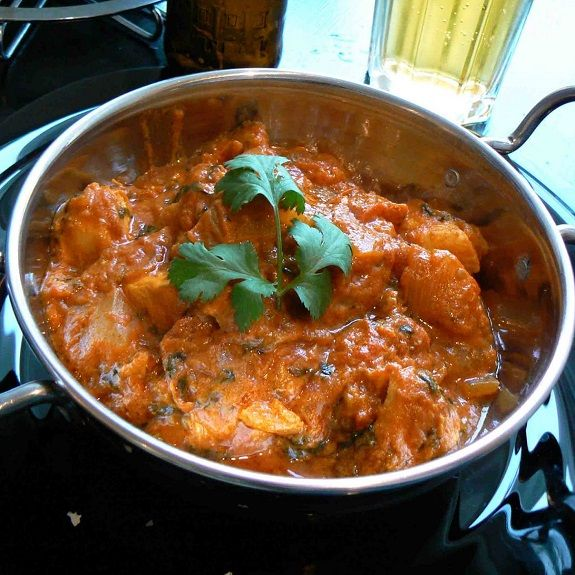 Baked chicken Rogan Josh belongs to Fine Indian cuisine. The Moguls,known for the splendor and grandeur they brought to 16-century India,originated this style of preparation as a lamb dish. I have substituted chicken for the lamb and marinated it in yogurt to tenderize the meat.
