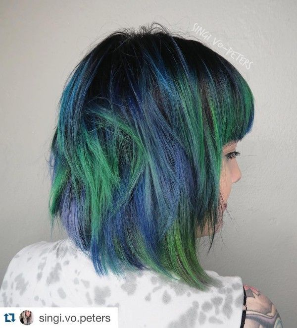 black hair and blue and green highlights