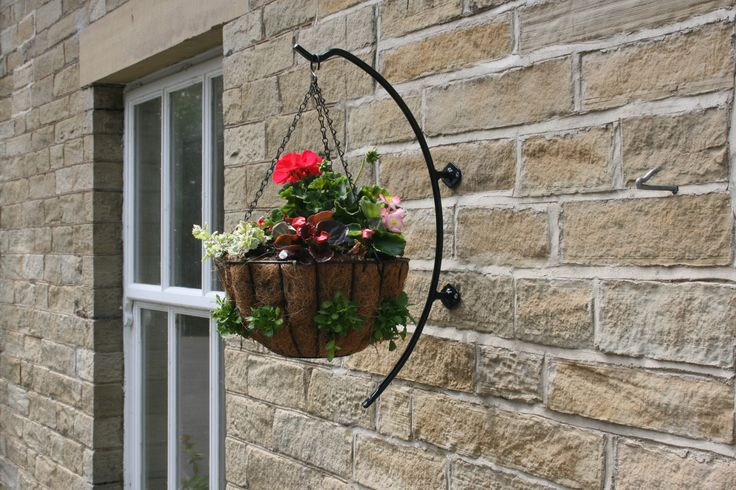 The cradle hanging basket bracket, we find to be a simple yet effective way of presenting a flower basket. As the title suggests, it cradles a presentation with the forged metal.