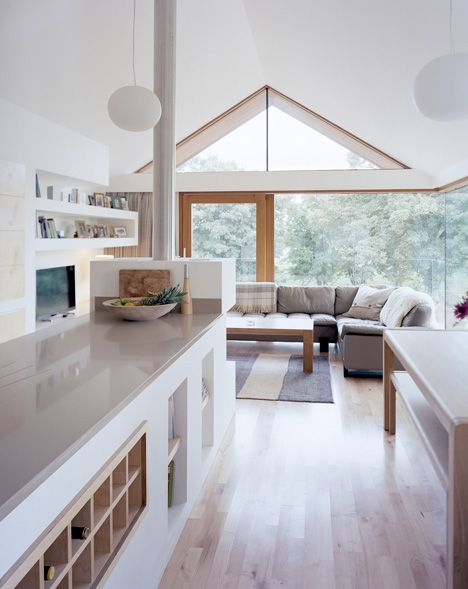 Interior shot of traditional stone barn updated with a steel-framed living space.