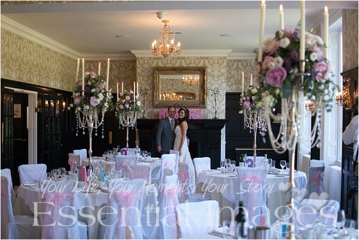 The new Mr and Mrs with their stunning wedding breakfast room. http://www.essentialimagesweddings.co.uk
